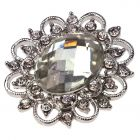 St Etienne - al large central gem surrounded by diamante and filigree metalwork