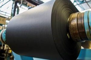 The enormous rolls of paper are formed onto the end of the machine.