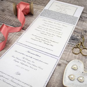 Lots of detail included in the handmade wedding invitations by Mandy price of Elegant Creations.