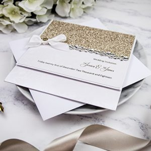 Beautiful handmade wedding invitations with glitter by Mandy price of Elegant Creations.