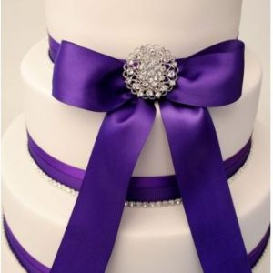 Satin ribbon is a brilliant way to add your wedding colour theme to your wedding cake