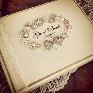Pretty vintage lace is the perfect addition to this heirloom guest book
