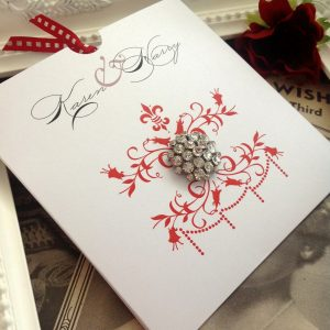 A stunning diamante gem on a wedding invitation wallet