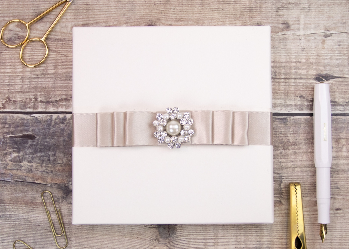 Boxed wedding invitations add intrigue and offer protection