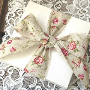 Hand delivered invitations with beautiful bows