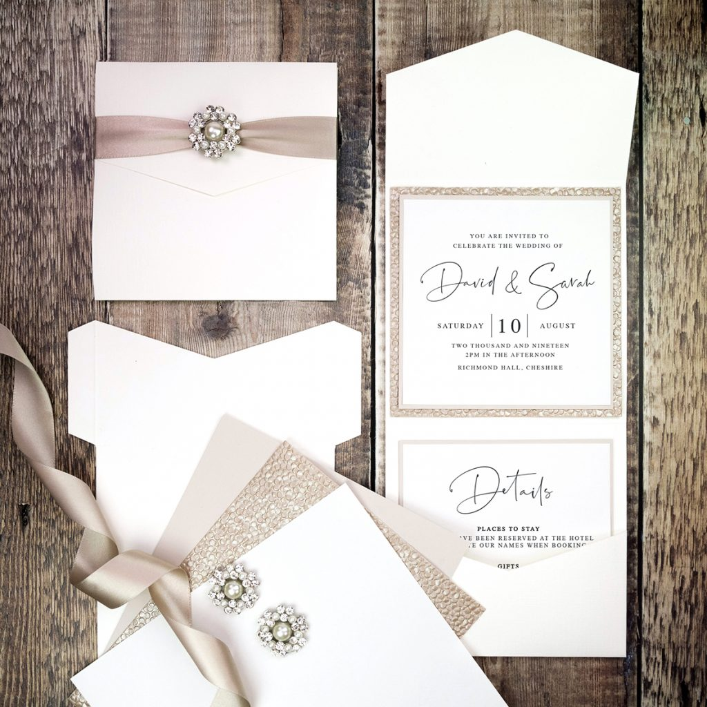 Large square pocketfold wedding invitations.