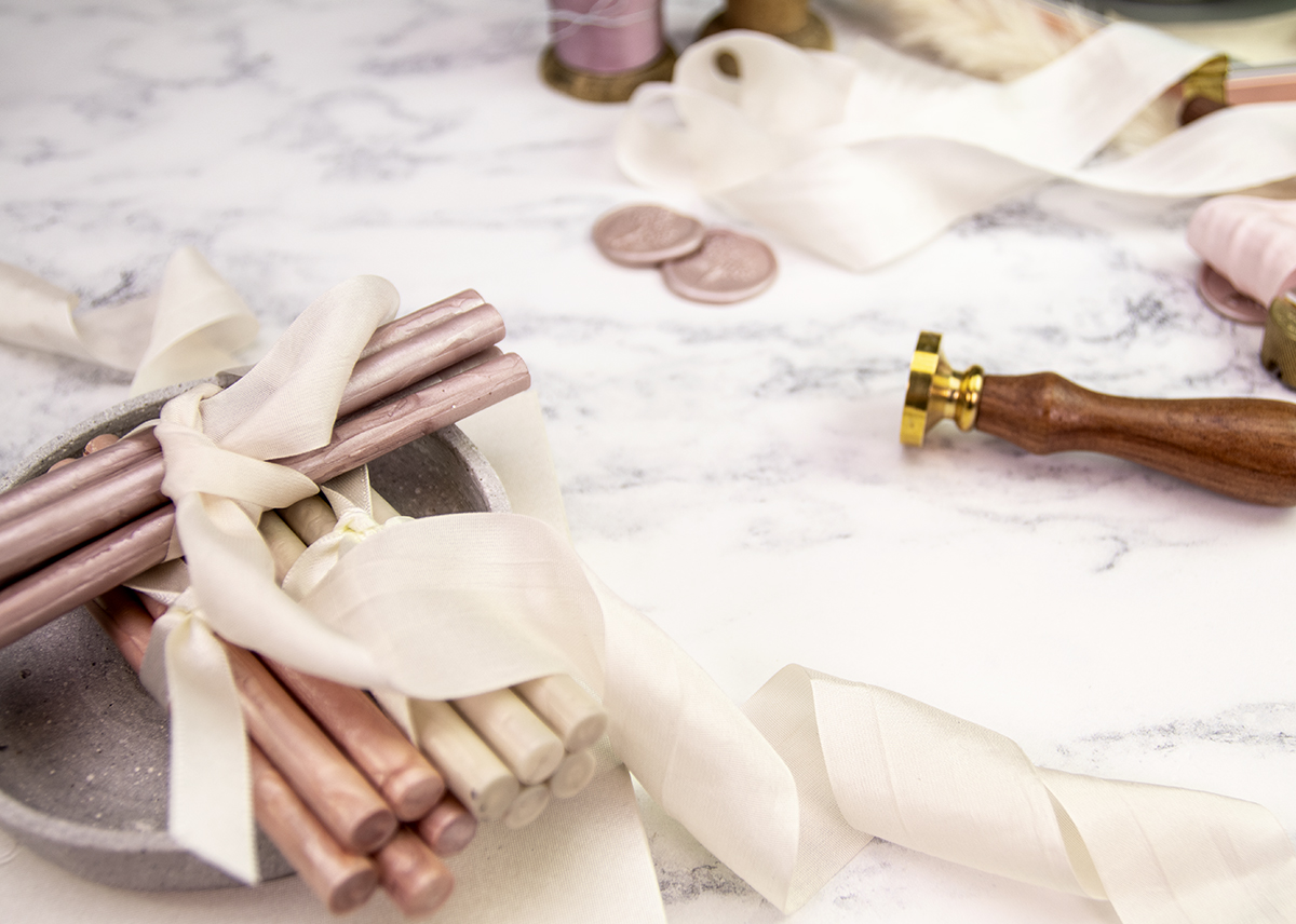 Making your own rose gold wedding invitations.