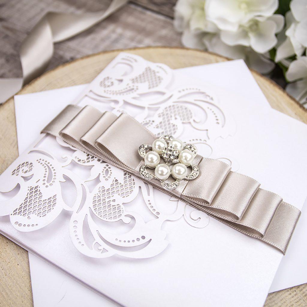 Lasercut invitation with diamante embellishment