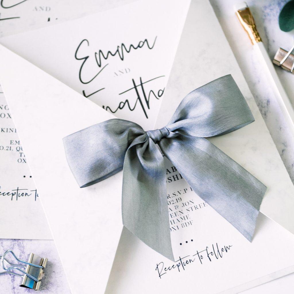 Weddings invitations using silk ribbon
