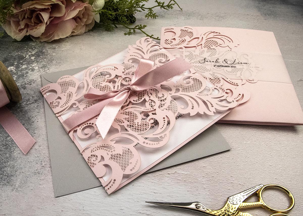 Pale pink wedding stationery.