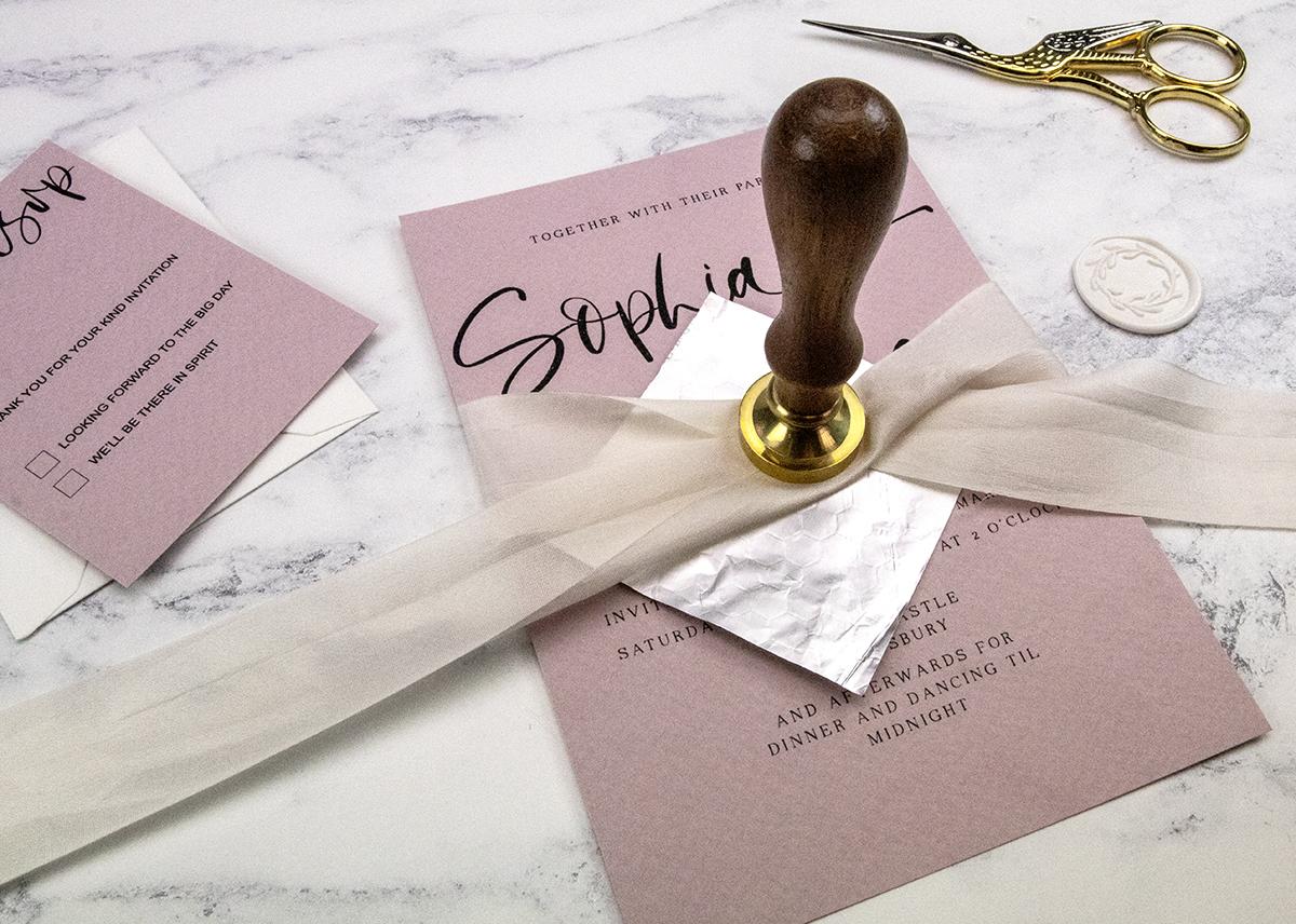 Making wedding invitation wax seals.