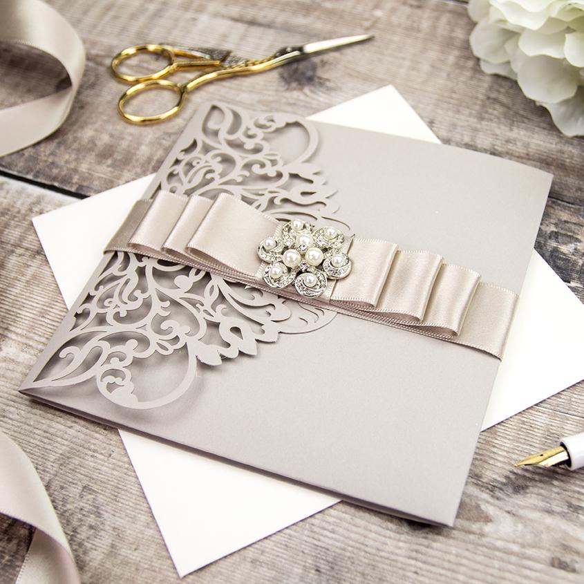 Stunning champagne laser cut wedding invitations