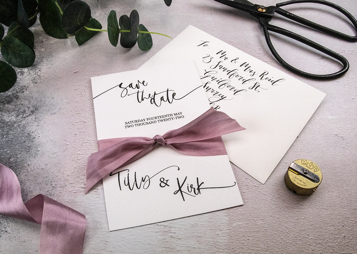 Save the Date cards with rose silk ribbon.
